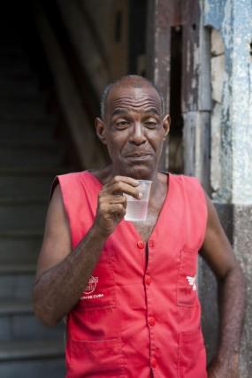 Cuba, man in doorway drinking rum
