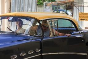 Cuba, Havana Vieja,  couple in antique car
