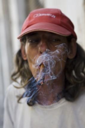 Cuba, Havana Vieja, man smoking cigar