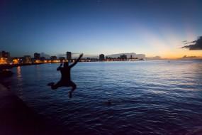Cuba, Havana, boy jumping off Malecon