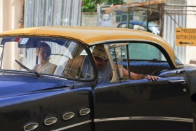 Cuba, Havana Vieja,  couple in antique car
