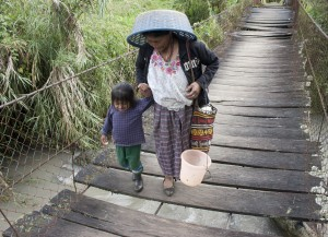 Grandmother And Granddaughter Cross A Tributary Stream Of The Q'ambalam River To Harvest Coffee  And Gather Water.